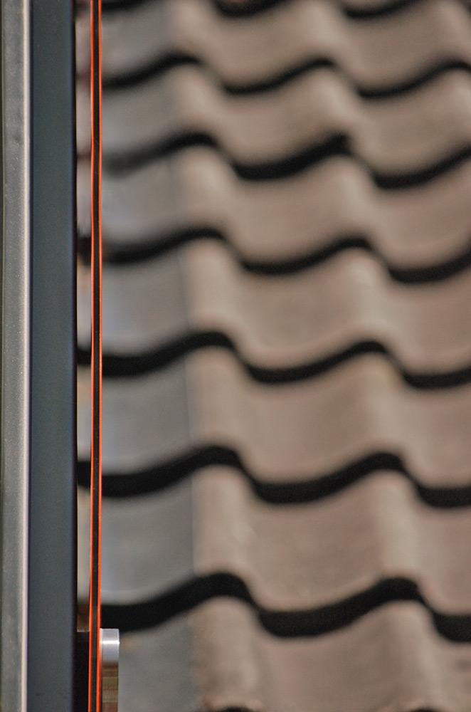 Schmals Stirmseite Glasscheibe Gaubenverkleidung Roik Architekt Hamburg.